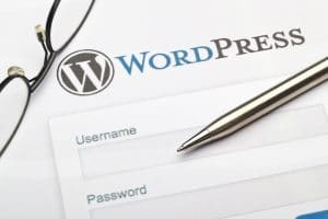 wordpress logo and login page with glasses and digital stylus